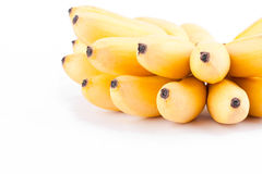 成熟金黄香蕉的黄色蛋香蕉或手在白色被隔绝的背景健康Pisang Mas香蕉果子食物的 库存图片