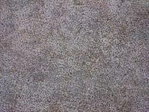 成颗粒状的石背景纹理 花岗岩或具体灰色dotte 库存图片
