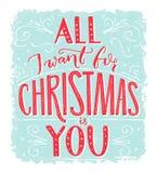 我为圣诞节要的所有是您 与浪漫行情的贺卡 在蓝色霜纹理背景的红色字法 免版税库存图片
