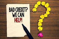 我们可以帮助的词文字文本坏信用问题 借户的企业概念与高危险的债务财政书面被撕毁的页 免版税库存照片
