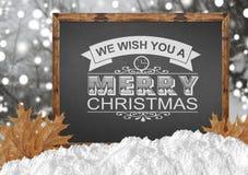 我们祝愿您在黑板的圣诞快乐有blurr森林叶子的 库存图片