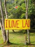 我在Vang Vieng,老挝爱老挝人横幅 库存图片