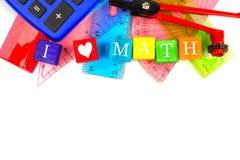 我心脏算术与学校用品边界的玩具块 图库摄影