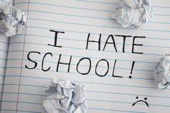 我教育的怨恨 词组我恨笔记本板料的学校与一些 免版税库存照片