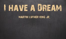我有梦想和马丁路德金,小 写在白垩在a 免版税库存图片