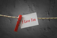 我爱你卡片附有与晒衣夹的一条绳索 库存图片