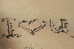 我爱你在海滩沙子  库存照片