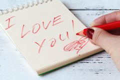 我爱你在笔记本页的词 库存照片