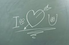我爱你在黑板 库存照片