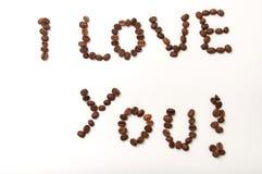 我爱你签字用在白色背景的咖啡豆 免版税图库摄影