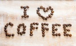 我爱在木背景的咖啡 图库摄影
