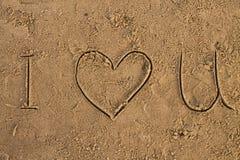 我爱在海滩的U标志 库存图片