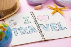 我爱在笔笔记本写的旅行 假期假日概念 免版税库存图片