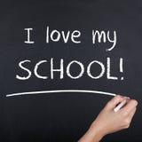 我爱我的关于黑板的学校笔记 免版税图库摄影