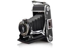 我的老减速火箭的照相机在白色屏幕上分离了 库存照片