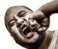 我秃头人得到了在面孔的拳打在被隔绝的背景中 免版税库存图片