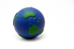 我紧压的球地球 图库摄影
