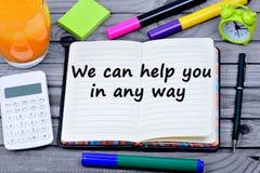 我们可以帮助您在任何情况下在笔记本的词 免版税库存图片