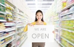 我们是在百货商店的开放标志板 图库摄影