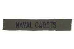 我们海军军校学生制服徽章 免版税库存图片
