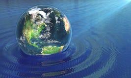 我们的地球在水中 库存照片