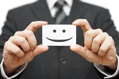 我们的客户是愉快的客户,在名片的微笑 免版税库存照片