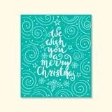 我们祝愿您圣诞快乐-引述在被仿造的背景 图库摄影