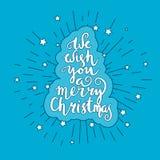 我们祝愿您圣诞快乐-引述在被仿造的背景 免版税图库摄影