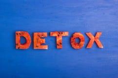 戒毒所词由切片西瓜做成 饮食,洗涤的身体,健康吃的概念 免版税图库摄影