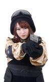 战士制服的女孩有手枪的 免版税库存图片