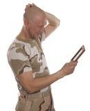 战士和照片 免版税库存照片