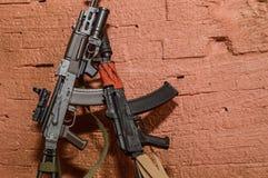 战士的辅助部件开枪图的玩具缩样 库存照片