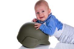 战士盔甲的婴孩 免版税库存照片