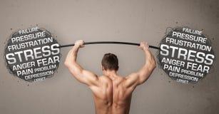 战斗与重音的肌肉人 免版税库存照片