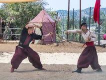 战斗在耶路撒冷`的节日`骑士的两个乌克兰哥萨克人在耶路撒冷,以色列 库存照片
