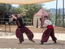 战斗在耶路撒冷`的节日`骑士的两个乌克兰哥萨克人在耶路撒冷,以色列 图库摄影