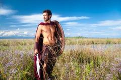 战斗的古老战士在风景背景中 库存照片