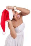 戴圣诞老人帽子的新非洲裔美国人的妇女 库存照片