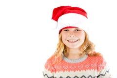 戴圣诞老人帽子的青春期前的女孩 库存照片