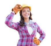 戴着安全帽和手套的女性建筑工人 图库摄影