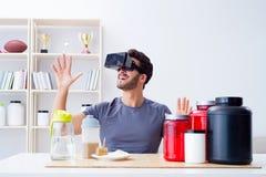 戴营养瓶子和虚拟现实眼镜的人 库存图片