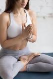 户内瑜伽:Ardha Padmasana 免版税图库摄影
