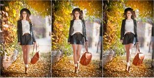 户外秋季射击的可爱的少妇 有摆在公园的皮革背包的美丽的时兴的学校女孩 图库摄影