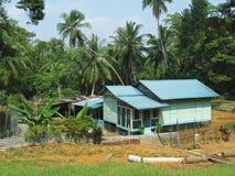 房子传统kampung的高跷 库存图片