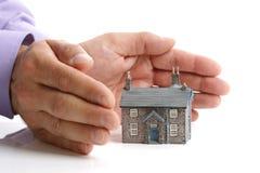 房子保护您 免版税库存照片