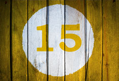 房子号码或历日在白色圈子在被定调子的黄色 免版税图库摄影