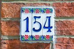 房子号码154标志 免版税库存照片