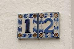 房子号码12签到陶瓷砖 免版税库存图片