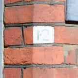 房子号码12被绘的标志 免版税图库摄影