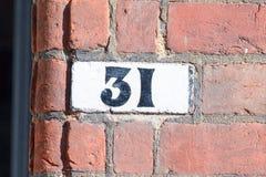 房子号码31被绘的标志 免版税库存图片